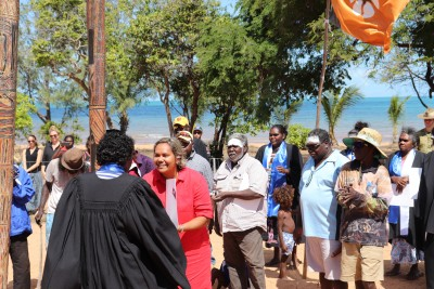 Minister for Education, Aboriginal Affairs and Workforce Training, the Hon Selena Uibo, delivers certificates to graduands at Menzies graduation ceremony held at Yilpara